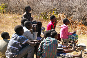 Grade six students listening to stories about Zambia