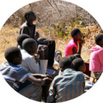 Grade-six-students-listening-to-stories-about-Zambia-300x200